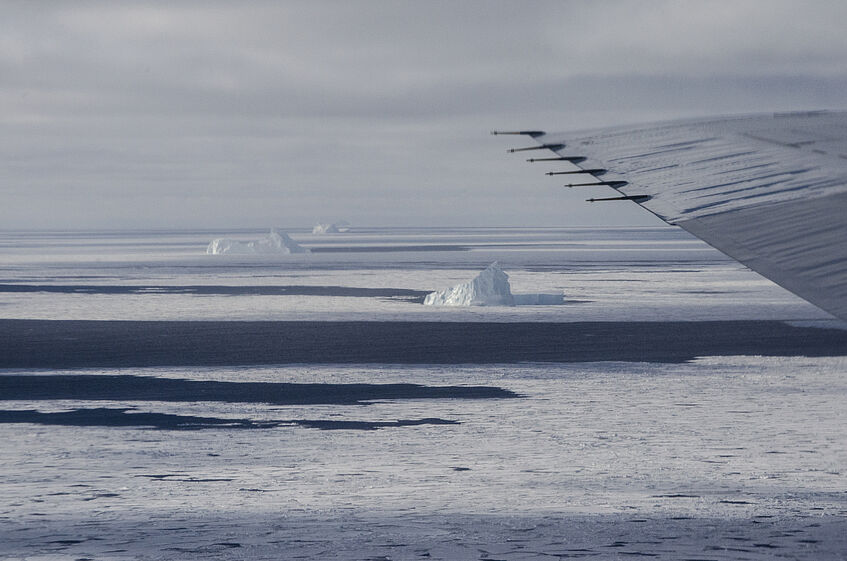 Flying in low altitude near some icebergs.